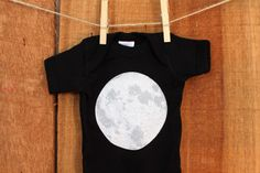 With this new and adorable onesie, you can be over the moon for your baby!  Baby bodysuit and toddler tee comes in black with a white fill moon graphic. All shirts are 100% cotton. Wash with like colors. Tumble dry low.