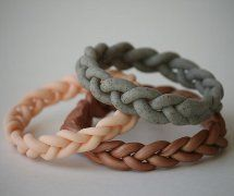 These super cute Braided Bangles are made using polymer clay! Learn how to make your own with this free tutorial.