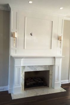Custom solid wood mantle and fireplace surround - designed, built, painted white and installed in a Jacksonville, Florida home by Borders Woodworks 904.524.5204.