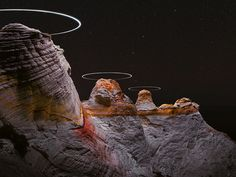 drone light paths above mountains captured in long exposure photography