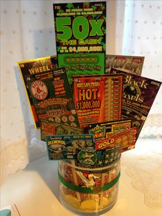 Lottery Ticket Bouquet with lottery tickets, Payday candy bars, 1000 Grand candy bars, and gold coins.  Great for a gift or raffle prize!