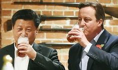 Xi Jinping and David Cameron drink their pints of beer at a pub in Princess Risborough near Chequers in October 2015.