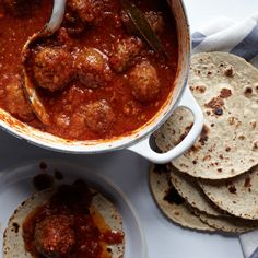 In Mexico, cooks usually prepare tinga with chicken, pork or vegetables. Alex Stupak stirs chorizo into the sauce, then adds meatballs to create a hearty dish.