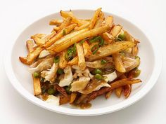Chicken and Cheese Poutine: A Canadian fast food turns into dinner with rotisserie chicken and fries topped with a gravy dressing.
