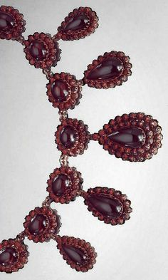 VICTORIAN GARNET NECKLACE ~ Garnet rosettes with five large tear shaped drop pendants.