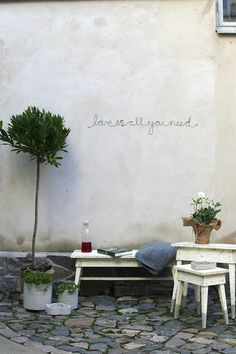 Love is all you need. Would probably do another quote but I like the idea of painting it on a garden wall