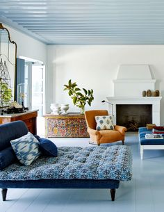 greek island living room in blue and orange | house tour via coco kelley