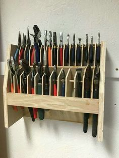How to organize and garage organization hacks. I've rounded up some of the best DIY garage organization ideas for you! Garage shelf with hooks. Garage Organization Tips, Garage Tool Storage, Workshop Storage, Garage Tools, Organizing, Garage Shop, Pegboard Storage, Car Workshop, Lumber Storage