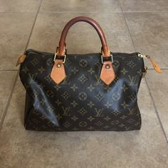 Authentic Louis Vuitton Speedy 30 Guaranteed authentic // good used condition // has lock and keys // no receipt, dustbag or box // Leather on handles has darkened // Needs to be cleaned either professionally or with tarnish remover safe for leather (has minor tarnishing on gold rivets around the bag which can be cleaned ) // interior is clean // I've had this for awhile but don't use it as much now so it needs a new home  Louis Vuitton Bags