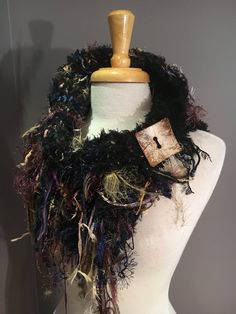 A personal favorite from my Etsy shop https://www.etsy.com/listing/550480610/hand-knit-split-shag-cowl-couture-black