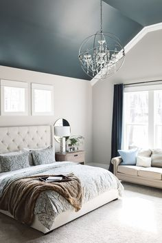 We chose to paint the ceiling dark to create a stunning backdrop for the chandelier. Ceiling paint color is Mount Etna SW7625 Sherwin Williams. (I would have taken the crown molding across the top of the windows, as well.)