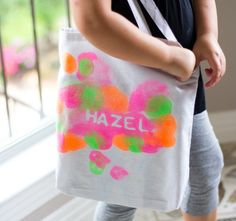 This simple kids craft idea was a big hit in our house. We got to try experimenting with fabric spray paint for the first time on theDIY tote bags and loved seeing the colorful results from the bright neon paints. This is such a fun summer craft idea for