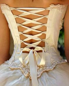 Tie back dress I'm not normally a fan of corset tie back dresses, but this one is unique and gorgeous!