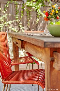 Outdoor table and chairs with small floral arrangement