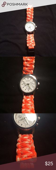 Orange and white chord watch Orange and white chord watch, never worn, don't know what the exact name for those woven chord bracelets are called. Needs a battery, hand made bought at a craft expo Accessories Watches