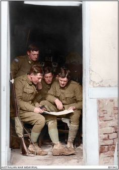 WWI; Officers and NCO's of the Australian 13th Machine Gun Company studying a map in a billet at Sailly-le-Sec, 29 March 1918. -Doug (@colour_history) | Twitter