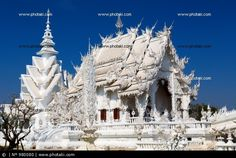http://www.photaki.com/picture-main-chapel-of-the-famous-wat-rong-khun-white-temple-in-thailand_980080.htm