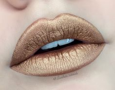 Champagne is a beautiful gold metallic! You'll definitely be making a beauty statement in this baby! Our matte metallic liquid lipsticks dry down completely mat