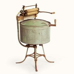 1920 Washing Machine | Operating the hand crank causes this metal tub to spin horizontally ...