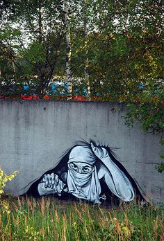 "P183 the Russian Banksy: Street art, says he's doing these works for a "" strong educated and cultured homeland "" Moscow, Russia"