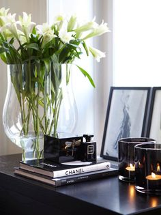 Visual feature-books, candles, pictures, flowers