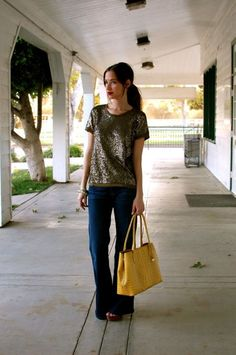 The glittery top paired with the casual jeans and bright bag, on a sunny day~
