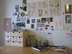 I love all these little photographs and drawings pasted up on the wall.