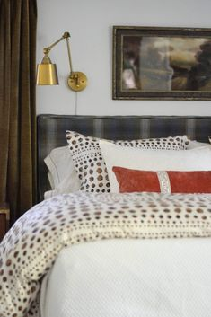 shibori bedding, brown curtains, brass light, vintage painting, Cate Holcombe Interiors