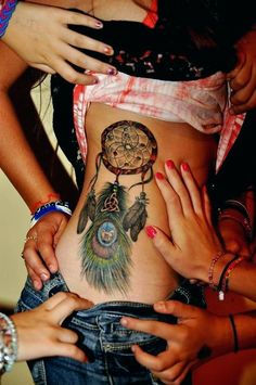 dreamcatcher tattoo on girl's sexy side