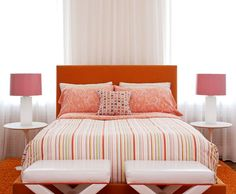 Spicy Mod Bedroom  This mod-inspired bedroom captures the spirit of the 1960s while highlighting modern lines and patterns. A powerful orange velvet headboard floats in front of a wall of white sheers. Vintage bedside table lamps are updated with bubblegum pink shades. Hot tangerine and coral create drama against glossy white walls and furnishings.