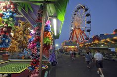 Ocean City, Md. The midway lights of Trimper's Rides and Amusements add color to the twilight sky on the boardwalk.
