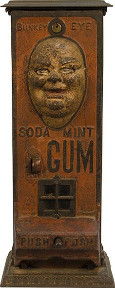 Blinkey Eye Soda Mint Gum, working .1¢ vending machine, rare, ca.1907. Embossed cast-iron case, the eyes blink when a piece of gum is dispensed, includes key; W:7 x D: 6 x H: 17""