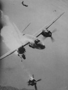 21 Aug 1944. B-26 Marauder of the 12th AF, 42nd Bomb Division loses its right engine after a direct flak hit. Moments after the picture was taken the stricken bomber crashed.