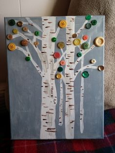 Button Tree art on canvas - I painted birch trees and hoped to do mostly yellow buttons (I LOOOVE how beautiful birch trees look in the fall!!), but alas...not so many yellow. So tried to stick with kind of autumny colors anyway. Pretty proud of my freehand birch-ing though! :D  Based on this tutorial - http://craftsbyamanda.com/2012/05/vibrant-button-tree-on-canvas-a-giveaway.html