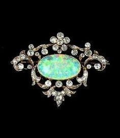 An opal and diamond brooch/pendant, circa 1900. |  © Bonhams 2001-2015