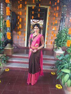 South Indian bride. Gold Indian bridal jewelry.Temple jewelry. Jhumkis. Pink and brown silk kanchipuram sari.Braid with fresh jasmine flowers. Tamil bride. Telugu bride. Kannada bride. Hindu bride. Malayalee bride.Kerala bride.South Indian wedding.