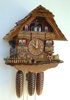 Model #8TMT 6419/9 Schneider Musical Black Forest House Cuckoo Clock, Animated Wanderer, Water Wheel and Dancers.