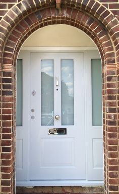 Victorian front door with 2 glazed side lights and polished chrome hardware Porch Doors Uk, Windows And Doors, Victorian Front Doors, Victorian Windows, Composite Front Doors Uk, Porch Canopy, Grey Hallway, Traditional Doors, House Front