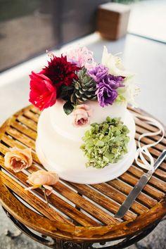 Wedding cake adorned with fresh flowers // photo by LoveKatieAndSarah.com