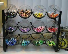 Wine rack and glasses repurposed for color pencils. This would be cute storage for craft supplies, makeup, etc.