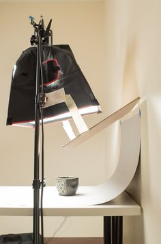 How to photograph your pots with one light. Cardboard positioned to create a gradient on a background