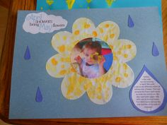 Micheal's flower cut out and children use q-tips to put dots of paint on the flower.  I then glue a picture of the child in the middle and made a scrapbook page for the parents.