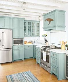 Decorating Kitchen teal kitchen cabinets with glass fronts, marble countertops, subway tile backsplash, beach cottage kitchen remodel - A beach cottage's rundown cook space becomes a year-round haven Teal Kitchen Cabinets, Kitchen Redo, New Kitchen, Maple Cabinets, Kitchen Ideas, Kitchen Designs, Glass Cabinets, Kitchen Backsplash, Kitchen Floor