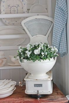 Soup tureen of flowers on a vintage scale