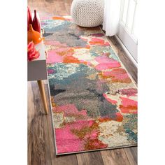 This area rug is crafted with easy-to-clean yarns that prevents shedding, unlike wool. The rug features a variety of modern shades that will enhance your decorative scheme. Features: Crafted with easy
