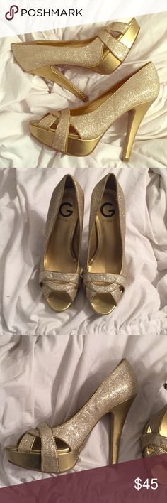 "Like New Sparkly Gold G by Guess  5"" Heels Only worn once, these G by Guess Gold Sparkly Heels are in excellent condition. Pictures show slight wear on soles, and small scratches on the heels. 5"" heels. 1"" platform  All serious offers considered, trying to clean out my closet! Thanks! G by Guess Shoes Heels"