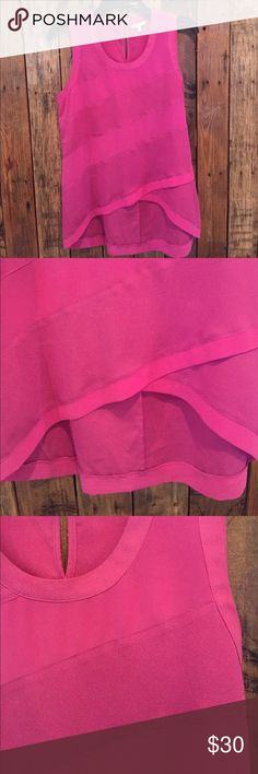 Top by Naked Zebra Size SMALL high-low top by naked zebra. This top has a purple/pink hue. It has a cute button detail on the back and an adorable high-low feature! Worn once. Naked Zebra Tops