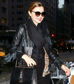 See How 10 Celebs Style Their Scarves for Winter via @WhoWhatWear