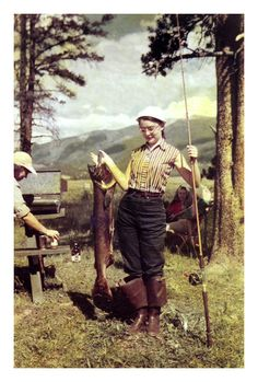 Vintage fishing girl > Voices for the Lake really digs this vintage photo, especially the waders she's got rolled down!