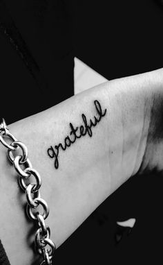 "Tiny Wrist Tattoo Tasteful ""grateful"" wrist tattoo, all lower case"